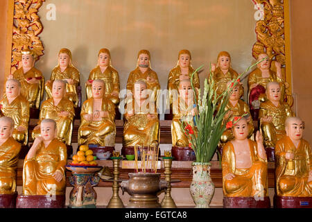 Buddha statue with Quoc Tu altar in the Pagoda, Ho Chi Minh City, Saigon, Vietnam, Southeast Asia - Stock Photo