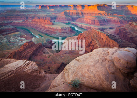 Dead Horse Point State Park in Utah features a dramatic overlook of the Colorado River and Canyonlands National - Stock Photo