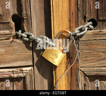 Padlocked and chained Old wooden panelled door. Vilaflor old town tenerife - Stock Photo