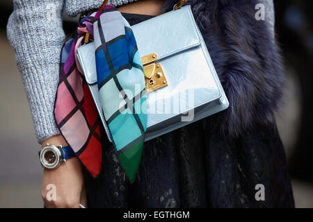 MILAN - FEBRUARY 26: Woman poses for photographers before Anteprima show with blue Louis Vuitton bag Milan Fashion - Stock Photo
