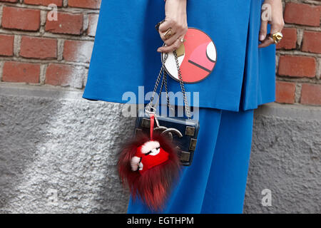 MILAN - FEBRUARY 26: Woman poses for photographers before Fendi show with Chanel bag Milan Fashion Week Day 2, Fall/Winter - Stock Photo