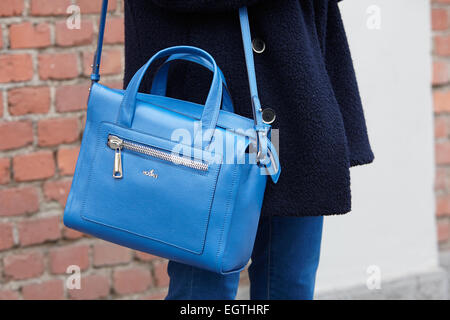 MILAN - FEBRUARY 26: Woman poses for photographers before Fendi show with Hogan bag Milan Fashion Week Day 2, Fall/Winter - Stock Photo