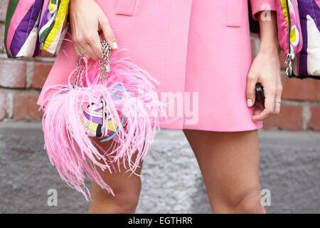 MILAN - FEBRUARY 26: Woman poses for photographers before Fendi show Milan Fashion Week Day 2, Fall/Winter 2015/2016 - Stock Photo