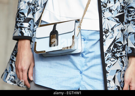 MILAN - FEBRUARY 26: Woman poses for photographers before Just Cavalli show with River Island bag Milan Fashion - Stock Photo