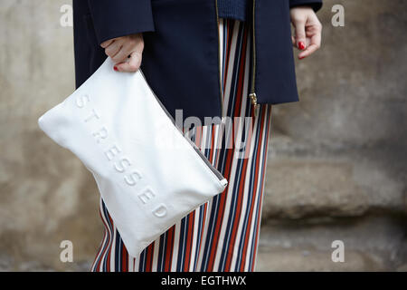 MILAN - FEBRUARY 26: Woman poses for photographers before Anteprima show with Zara stressed bag Milan Fashion Week - Stock Photo