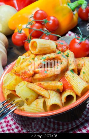 red gurnard soup with mezze maniche italian pasta - Stock Photo