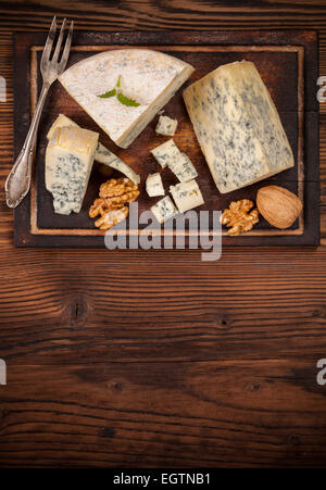 Still life of blue cheese served on wood. Shot from aerial view - Stock Photo