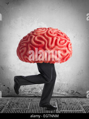 Metaphor of the brain drain. Rubber brain legs while running. - Stock Photo