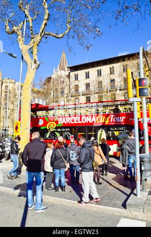 People waiting at traffic light. Barcelona, Catalonia, Spain - Stock Photo