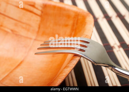 Fork detail in bowl on placemats - Stock Photo