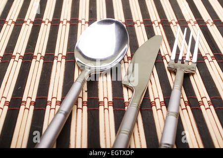 Cutlery on placemats - Stock Photo