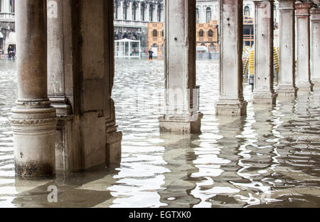 View of the arcades of the Piazza San Marco with high water in Venice, Italy. - Stock Photo