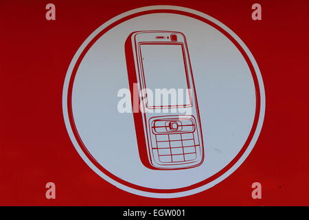 on a red background shows a mobile phone icon - Stock Photo