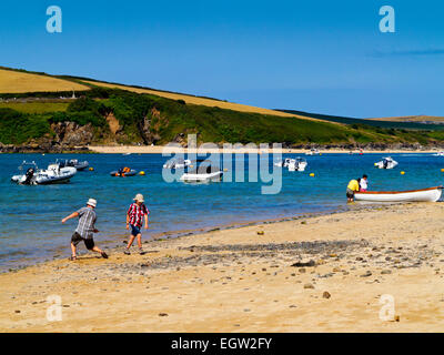 Holidaymakers in summer playing on the sandy beach at Rock on the River Camel Estuary near Padstow in North Cornwall - Stock Photo