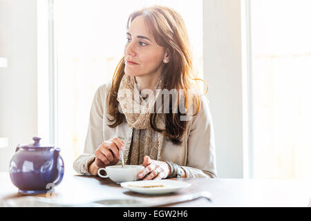 Woman having tea. - Stock Photo
