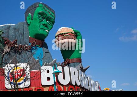 Niagara Falls, Ontario - Frankenstein eats a hamburger atop a Burger King store in Niagara Falls' Clifton Hill tourist - Stock Photo