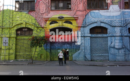 ROME - FREBRUARY 28, 2015: The Occupied Building in via del Porto Fluviale street covered with mural paintings - Stock Photo