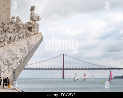 The Padrão dos Descobrimentos and the 25th April suspension bridge over the Tagus river in Lisbon, Portugal - Stock Photo