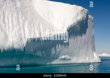 Antarctica, Weddell Sea, Antarctic summer melting tabular iceberg towering high above sea - Stock Photo