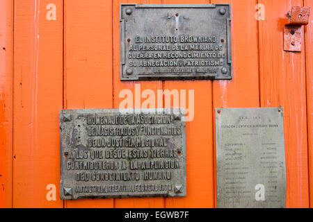 Antarctica, Graham Land, Paradise, Bay, Almirante Brown Naval Base, plaques on door - Stock Photo