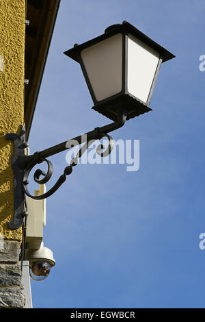 Old Lamp with CCTV Video Camera - Stock Photo