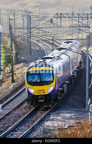 Trains, tracks & Passengers on First 185 105 Diesel passenger train on Shap ascent at Tebay, Shap, Cumbria, UK - Stock Photo