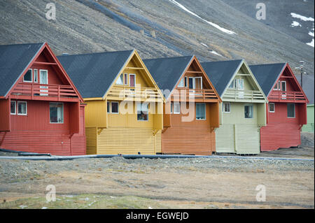 A row of colourful wooden Norwegian houses in the town of Longyearbyen on Spitsbergen, Svalbard - Stock Photo