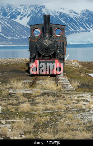 The old steam train used for mining in the past which now sits near the shore in Ny-Ålesund, Spitsbergen, Svalbard - Stock Photo