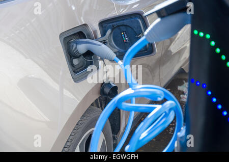Electric car electric vehicle on-street charging. London, UK - Stock Photo