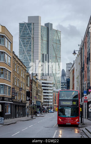 View along Curtain Road with Broadgate Tower in background and bus on street, City of London, UK - Stock Photo