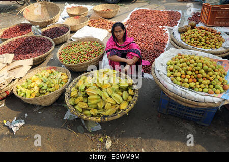 A women vegetable vendor waits for customers in a wholesale market at Kawran Bazar during a countrywide strike called - Stock Photo