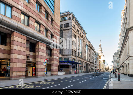 Views down Poultry in the City of London. 1 Poultry is on the left and St Mary le Bow church in the distance - Stock Photo
