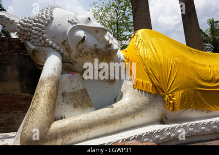 The Temple of the Reclining Buddha in Wat Yai Chai Mongkol in Ayutthaya in Thailand - Stock Photo