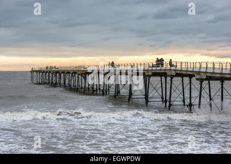 The sun begins to set over Saltburn-by-the-Sea Pier on a cold, Winter's day. - Stock Photo