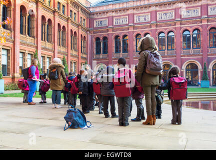 Primary school children on a school trip at the Victoria and Albert Museum, London, England, UK - Stock Photo
