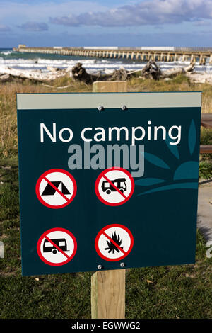 Sign in front of Tolaga Bay historic wharf in New Zealand - Stock Photo