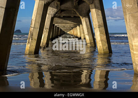 Historic pier in Tolaga Bay in New Zealand - Stock Photo
