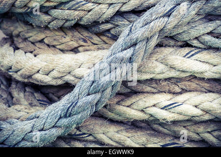 Gray nautical rope, closeup background texture, vintage toned photo with retro style filter - Stock Photo