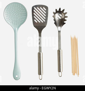 Slotted spoon, spatula, spaghetti claw and skewers - Stock Photo