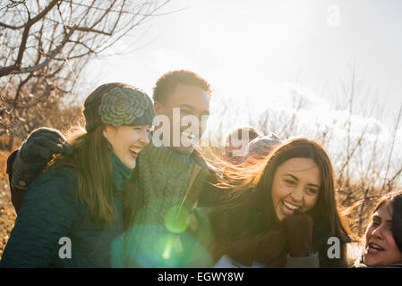 A group of friends on a winter walk. - Stock Photo