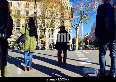 People waiting at a stoplight. Barcelona, Catalonia, Spain - Stock Photo
