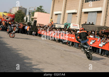 Motor cyclists KTM bikers perform stunts during the Hyderabad international auto expo on january 1,2000 in Hyderabad,India. - Stock Photo