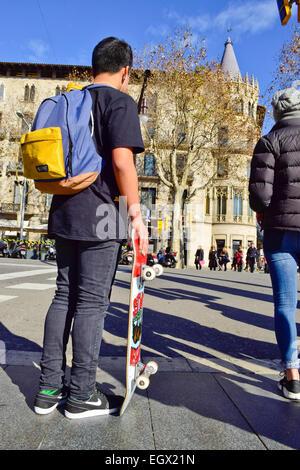 Skater waiting at stoplight. Barcelona, Catalonia, Spain. - Stock Photo