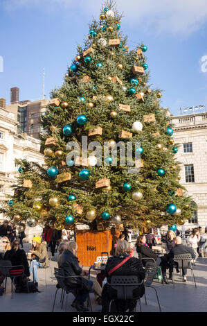 Fortnum and Masons christmas tree at the Somerset house ice rink in London in the lead up to christmas. UK. - Stock Photo