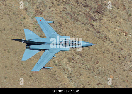 Royal Air Force Tornado GR4 Flying At Low Level Through A Desert Valley. - Stock Photo