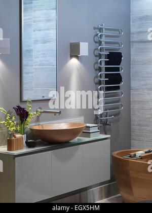 Wooden washbasin on unit in modern bathroom, UK home - Stock Photo