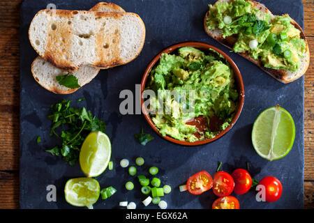 Canapes with avocado spread - Stock Photo