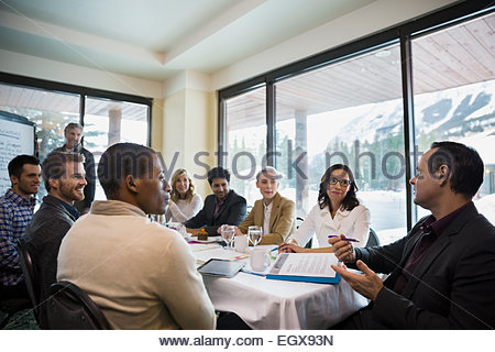 Businessman speaking in conference room meeting - Stock Photo