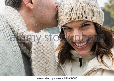 Portrait of enthusiastic couple wearing warm clothing - Stock Photo