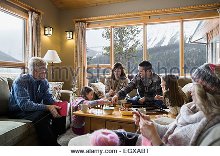 Multi-generation family relaxing in living room - Stock Photo